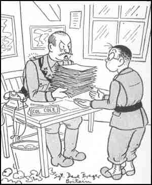 Col. Cole is telling Pvt. Breger, 'Arrenge these documents alphabetically and then burn them!' Artist: Dave Breger.