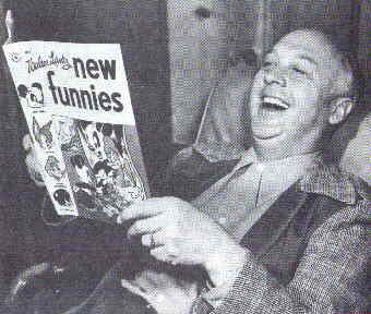 Walter Lantz enjoys his favorite comic book.