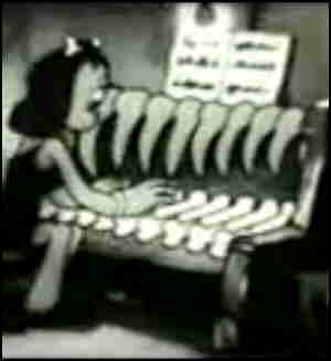 A young lady plays a stone age 'piano'.